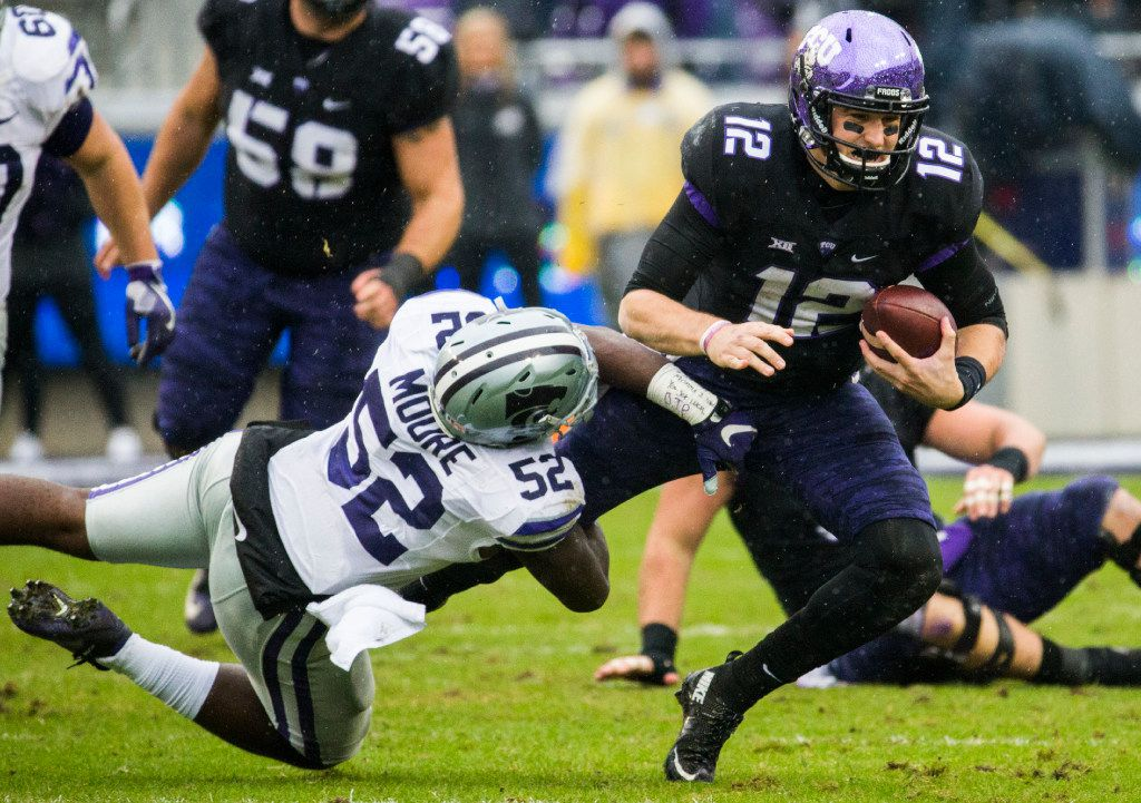 TCU Horned Frogs quarterback Foster Sawyer (12) is tackled by Kansas State Wildcats linebacker Charmeachealle Moore (52) during the second quarter of their game on Saturday, December 3, 2016 at Amon G. Carter Stadium in Fort Worth. (Ashley Landis/The Dallas Morning News)