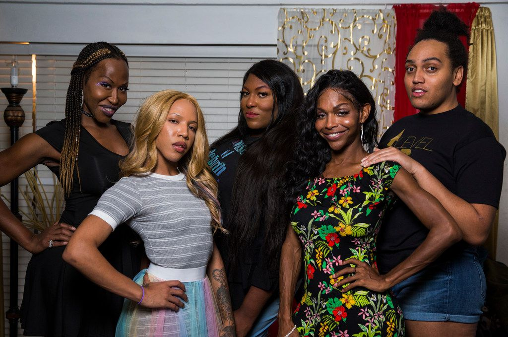 """From left, LeShay Weeks, Alana Bursey, Robyn """"Pocahontas"""" Crowe, Mieko Hicks, and Marquel Dominique pose for a photo on Friday, September 27, 2019 at Weeks' home in Dallas. The group hosts a weekly radio show called Trans-Fusion, where they talk about their experiences as black transgender women. (Ashley Landis/The Dallas Morning News)"""