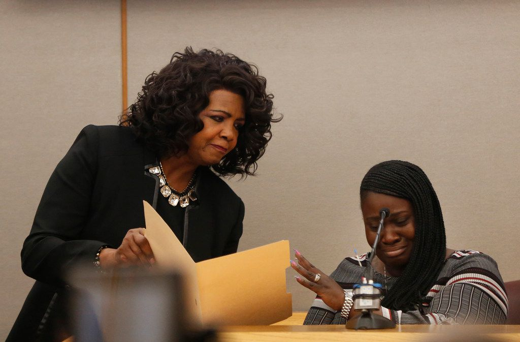 Charmaine Edwards pushes away an autopsy photo of  son Jordan Edwards shown to her by District Attorney Faith Johnson. (Rose Baca/Staff Photographer)