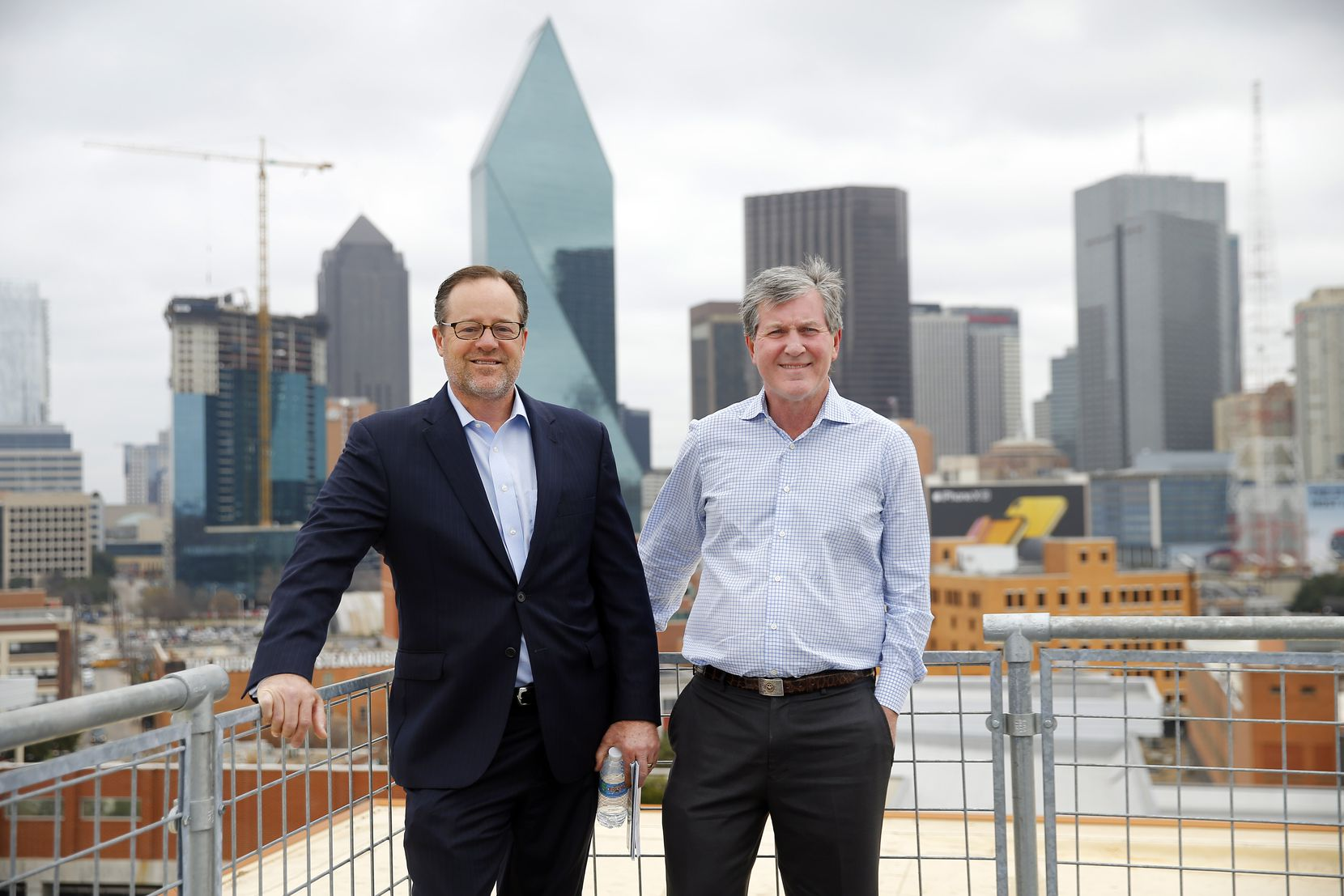The newly constructed Luminary has sweeping panoramic views of downtown, Uptown and the Trinity River in Dallas. It also has an eighth-floor rooftop view, where Crescent Real Estate's John Zogg (right) and JLL's James Esquivel are pictured.