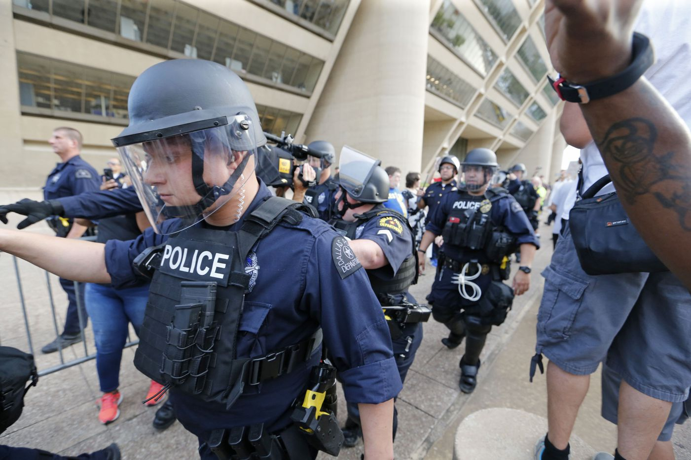 Dallas Police move into place during the March Against White Supremacy at Dallas City Hall.