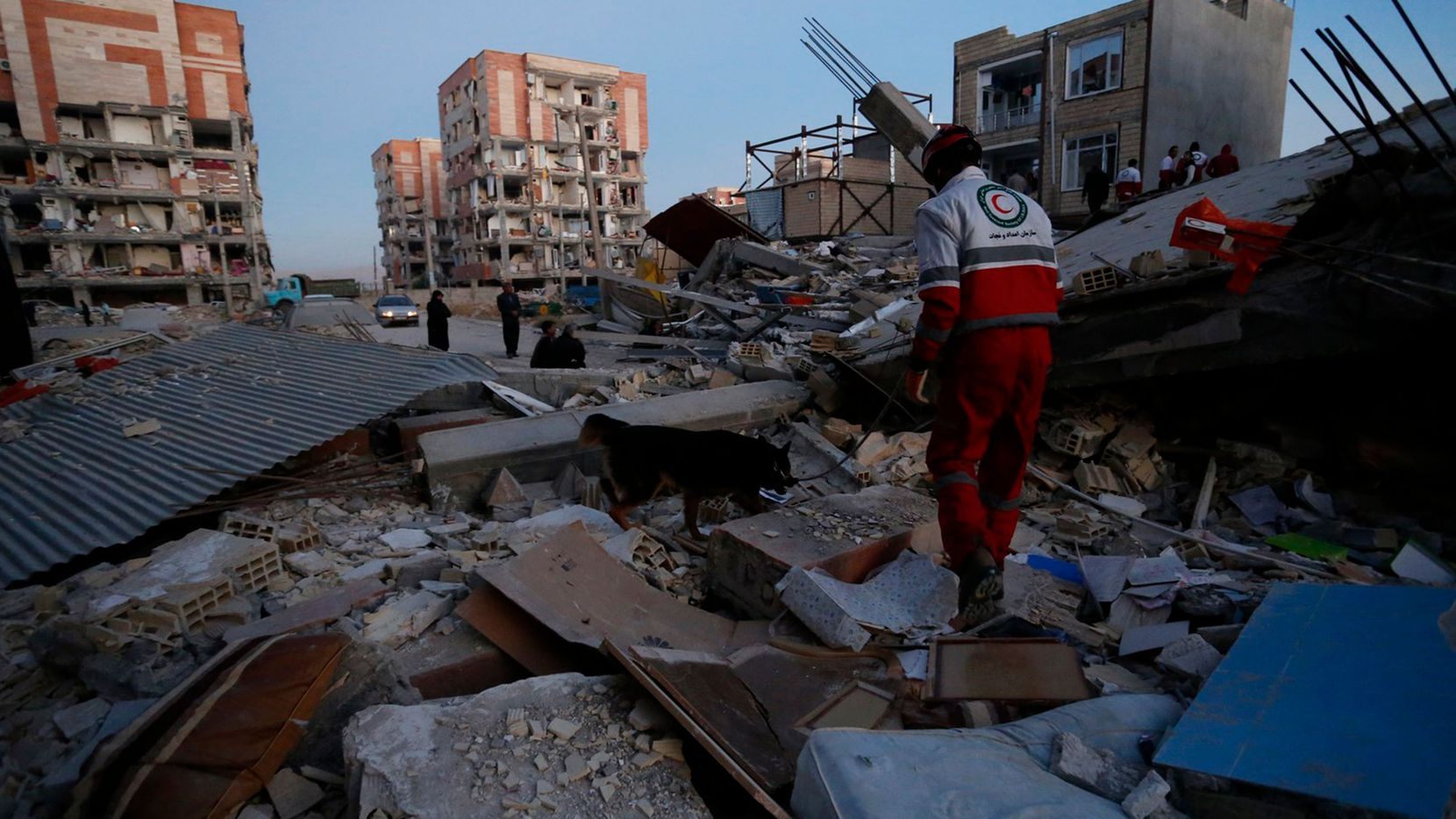 Rescue personnel conduct search and rescue work following a 7.3-magnitude earthquake at Sarpol-e Zahab in Iran's Kermanshah province.