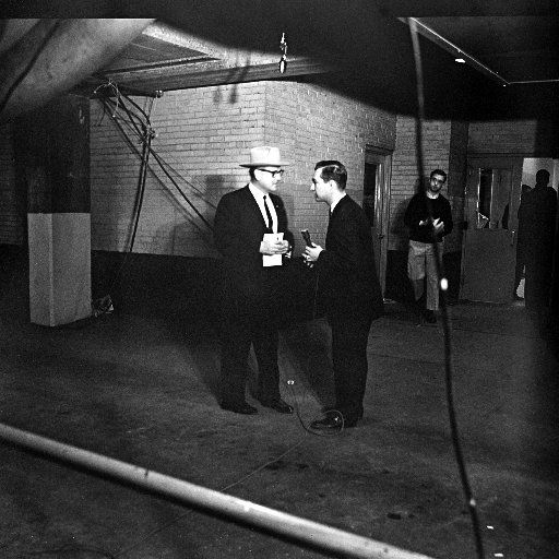 Bob Huffaker and a detective where Lee Harvey Oswald was shot.