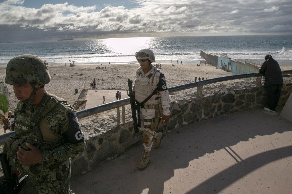 Mexican National Guard soldiers patrol near the border fence with the United States on September 28, 2019 in Tijuana, Mexico. Mexican President Andres Manuel Lopez Obrador, under pressure from the Trump Administration, sent the troops to border areas to stem the flow of Central American immigrants crossing into the United States.
