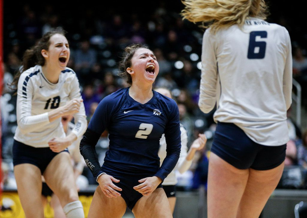 Flower Mound junior Sarah Martinez (2), senior Abby Butler (10) and sophomore Kaylee Cox (6) celebrate a point during the Class 6A volleyball state championship match against Ridge Point at the Curtis Culwell Center in Garland, Saturday, November 17, 2018. (Brandon Wade/Special Contributor)