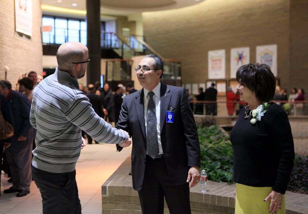 Garrett Landry (left), policy program coordinator for Teaching Trust, meets with new Irving ISD superintendent Jose Parra  and his wife, Genelle, during a meet and greet for the then-new Irving ISD superintendent in January 2014.