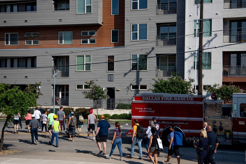 A Resident exits Elan City Lights apartments with a couple bags in Dallas on Monday, June 10, 2019. On Sunday, a crane collapsed into the apartments killing one and leaving five others injured. (Shaban Athuman/Staff Photographer)