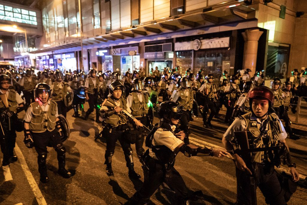HONG KONG, CHINA - SEPTEMBER 5: Police officers charge on a street to disperse protesters outside of Po Lam Station on September 5, 2019 in Hong Kong, China.  Pro-democracy protesters have continued demonstrations across Hong Kong since 9 June against a controversial bill which allows extraditions to mainland China, as the ongoing protests, many ending up in violent clashes with the police, have surpassed the Umbrella Movement from five years ago and become the biggest political crisis since Britain handed its onetime colony back to China in 1997. Hong Kong's embattled leader Carrie Lam announced the formal withdrawal of the controversial extradition bill on Wednesday, meeting one of protesters' five demands after 13 weeks of demonstrations. (Photo by Anthony Kwan/Getty Images)