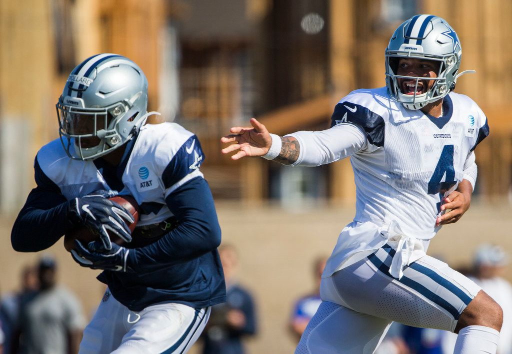 Dallas Cowboys quarterback Dak Prescott (4) hands off the ball to running back Tony Pollard (36) during an afternoon practice at training camp in Oxnard, California on Wednesday, August 7, 2019. (Ashley Landis/The Dallas Morning News)