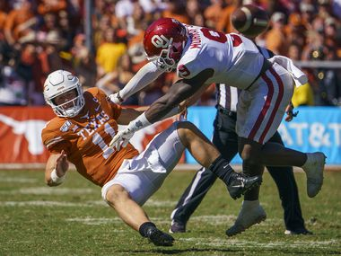 Texas quarterback Sam Ehlinger (11) is hit by Oklahoma linebacker Kenneth Murray (9) after getting off a pass during the second half of an NCAA football game at the Cotton Bowl on Saturday, Oct. 12, 2019, in Dallas. Murray was called for roughing the passer on the play. (Smiley N. Pool/The Dallas Morning News)