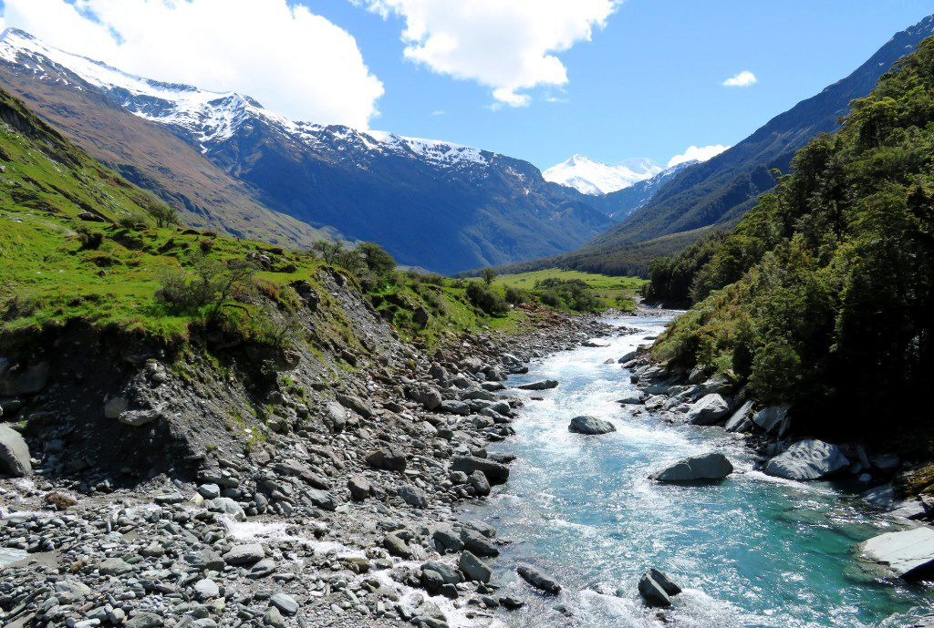 From the Rob Roy Track, hikers can glimpse Mount Aspiring behind the Matukituki River.