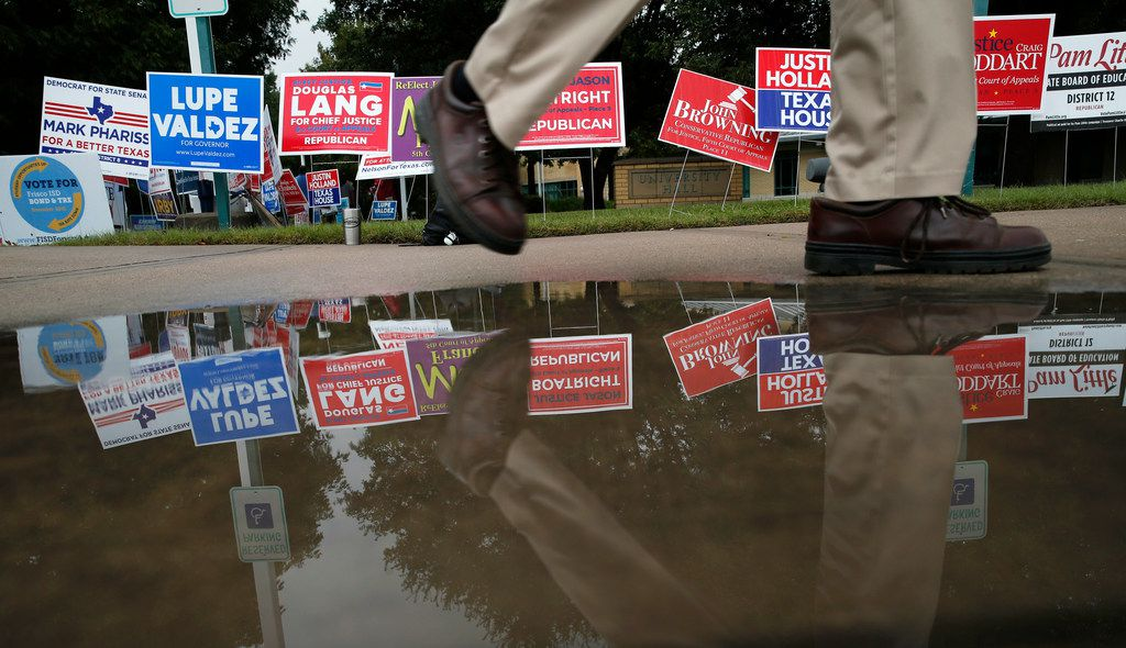 A voter made his way back to his car after voting at Collin College in Frisco on Thursday. Early voting for the Nov. 6 election continues through Nov. 2.