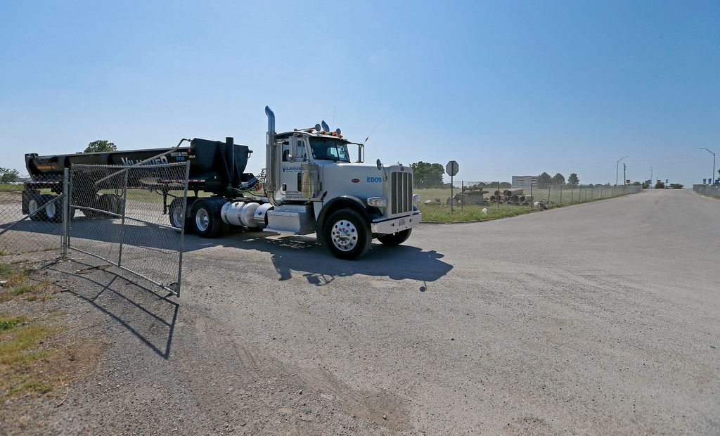 A truck leaves the Bayside project area near Lake Ray Hubbard in Rowlett on Thursday (Jae S. Lee/Staff Photographer)