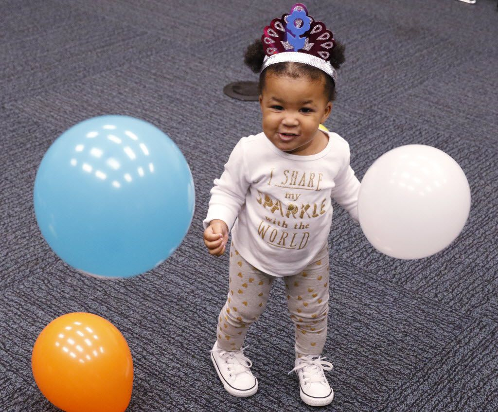 Grace Phillips, 1, celebrates early during a Noon Year's Eve Bash in 2015.