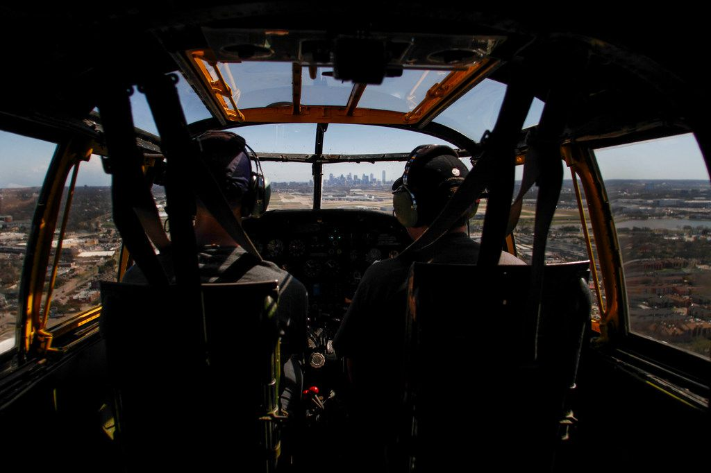 Pilot Will Dismukes and co-pilot Eric Whyte with the Collins Foundation fly a North American B-25 Mitchell Bomber into Love Field Airport with downtown Dallas in view as part of their Wings of Freedom Tour on Wednesday, March 13, 2019.