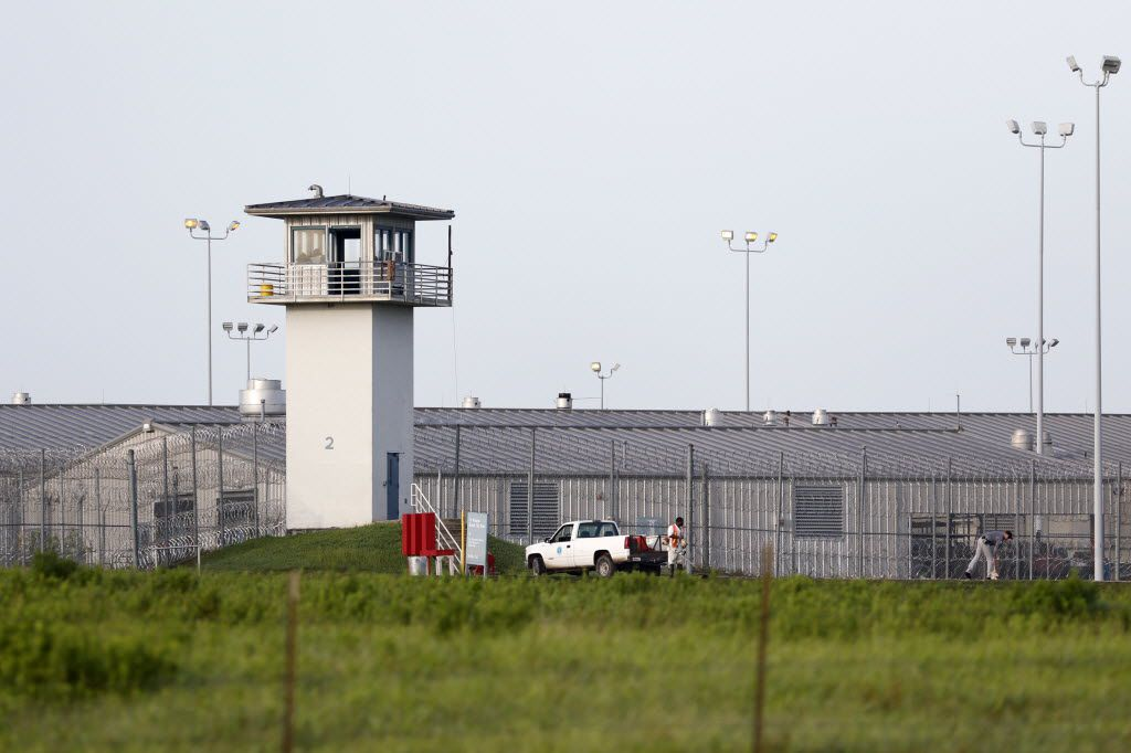 An inmate works outdoors at a Texas prison unit in Huntsville last year.
