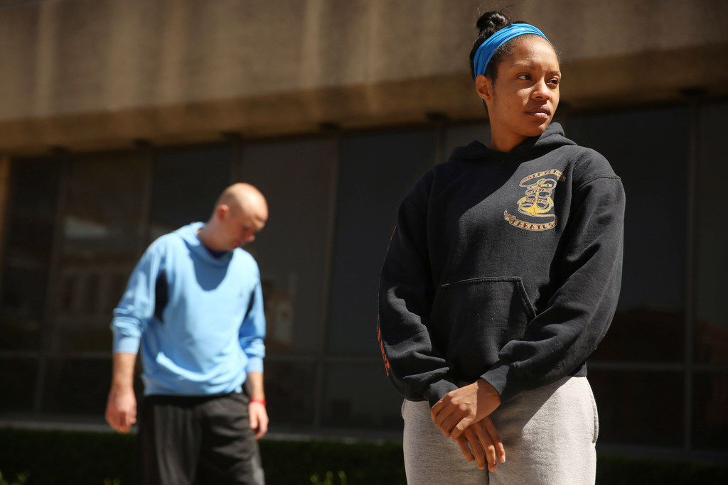 Amanda Martin gets ready to perform a push-up as part of a gantlet of tests to become a Dallas police recruit.