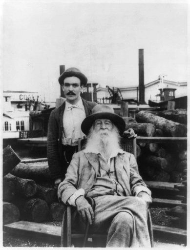 In this undated black and white photo provided by the Library of Congress, Walt Whitman poses with one of his nurses, Warren Fitzinger, in Camden, N.J., in the last years of Whitman's life.