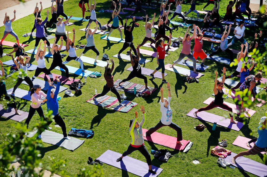 Indigo Yoga hosts a free yoga class on the lawn outside Press Cafe at The Trailhead at Clearfork in Fort Worth.