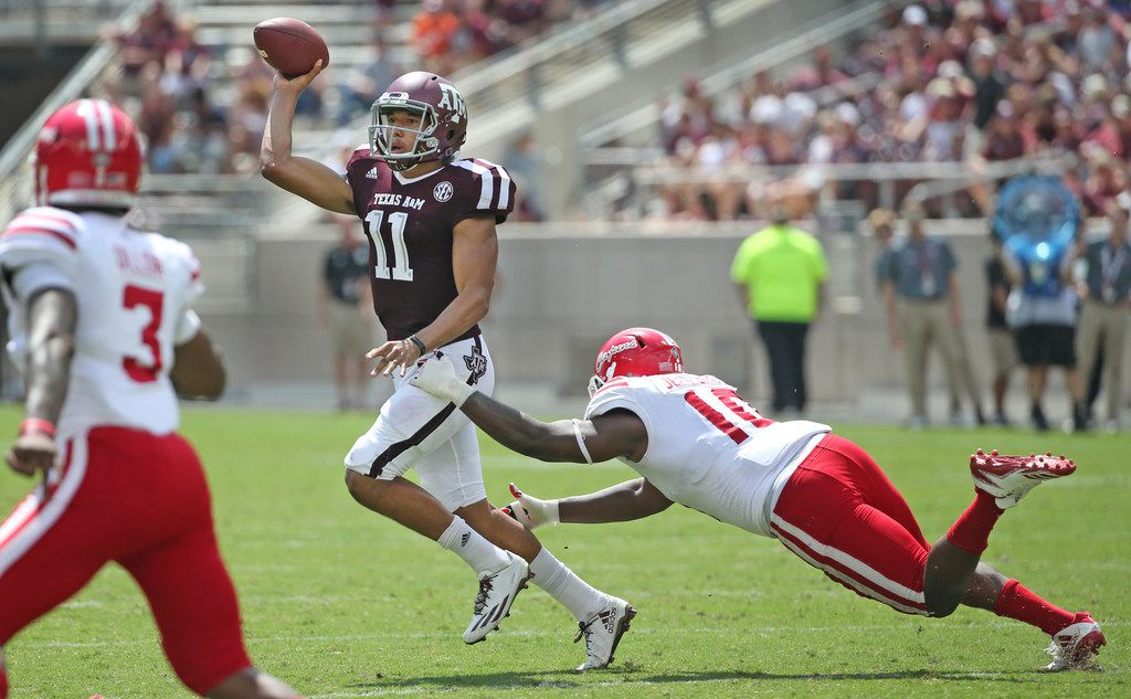 Texas A&M quarterback Kellen Mond (11) gets a pass away under pressure from Louisiana-Lafayette defensive end Jarvis Jeffries (10) during the Louisiana Lafayette Ragin' Cajuns vs. the Texas A&M Aggies at Kyle Field in College Stadium, Texas on Saturday, September 16, 2017. (Louis DeLuca/The Dallas Morning News)
