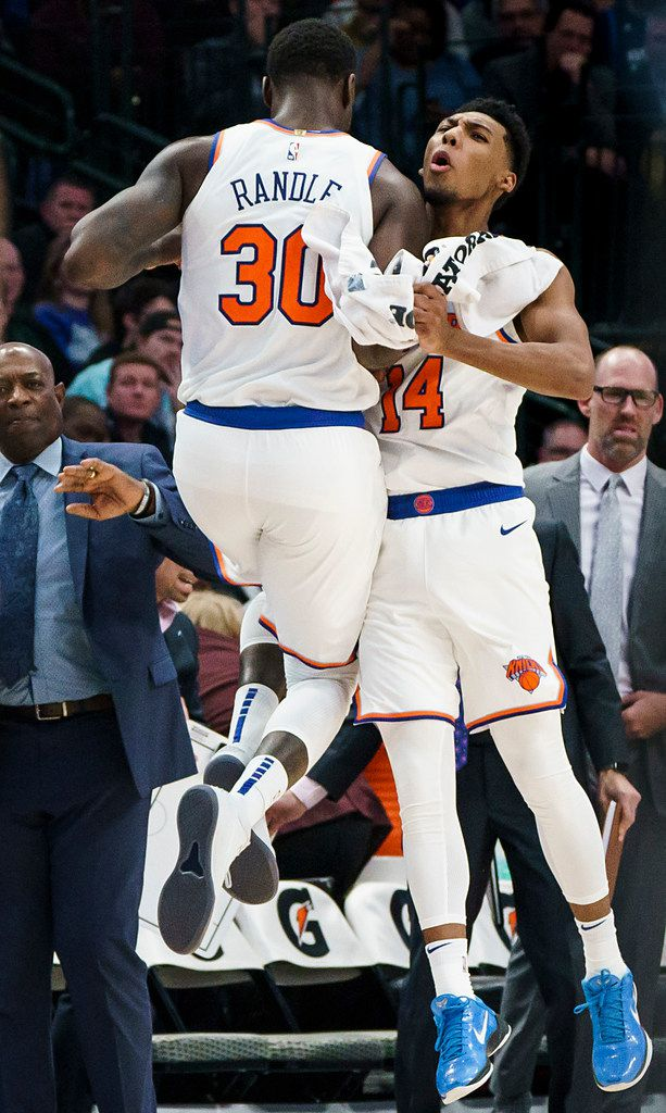 New York Knicks guard Allonzo Trier (14) celebrates after a basket made by forward Kevin Knox II (20) during the second half of an NBA basketball game at American Airlines Center on Friday, Nov. 8, 2019, in Dallas. (Smiley N. Pool/The Dallas Morning News)