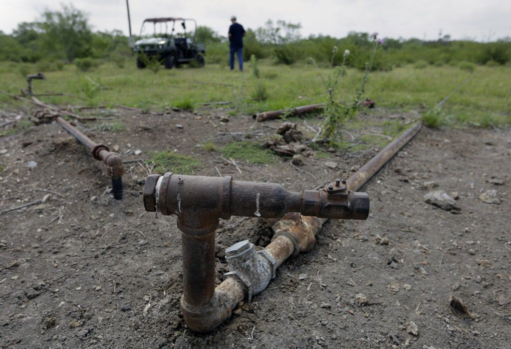 Parts of an injection well used to pump oil sits idle on a South Texas ranch near Bigfoot.