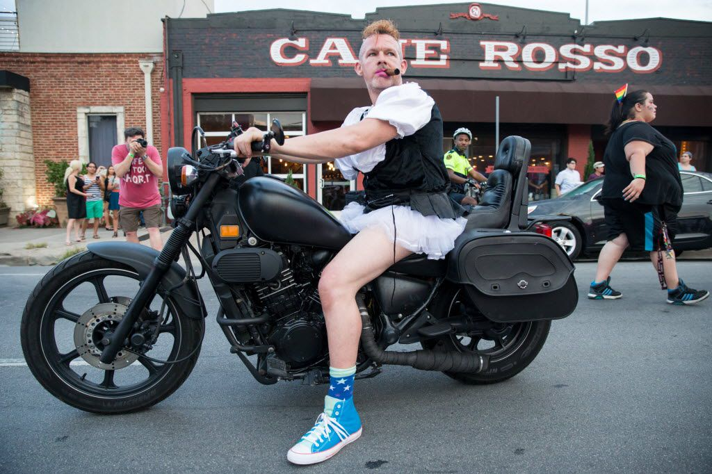 Damon Carver, of Fort Worth rides on his motorcycle during the Queer Bomb Dallas procession march though Deep Ellum streets on June 25, 2016 in Dallas. (Ting Shen/The Dallas Morning News)
