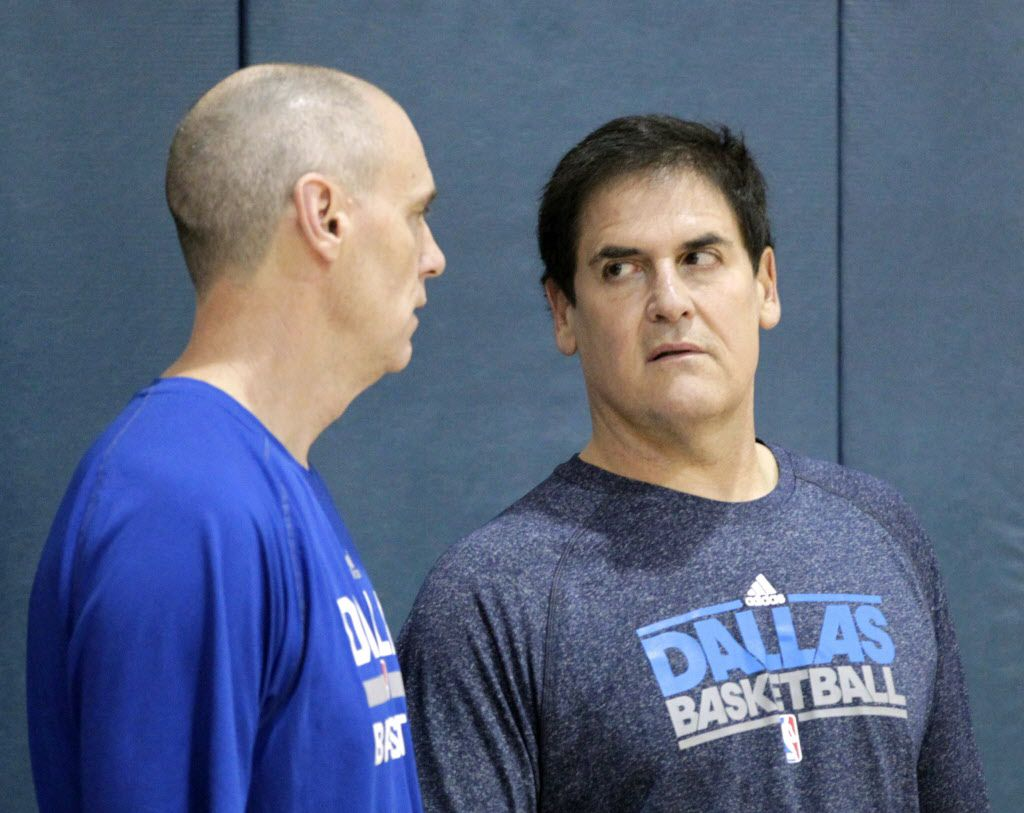 Dallas Mavericks head coach Rick Carlisle talks with owner Mark Cuban near the end of practice at American Airlines Center in Dallas, on Friday, July 10, 2015. (Vernon Bryant/The Dallas Morning News)