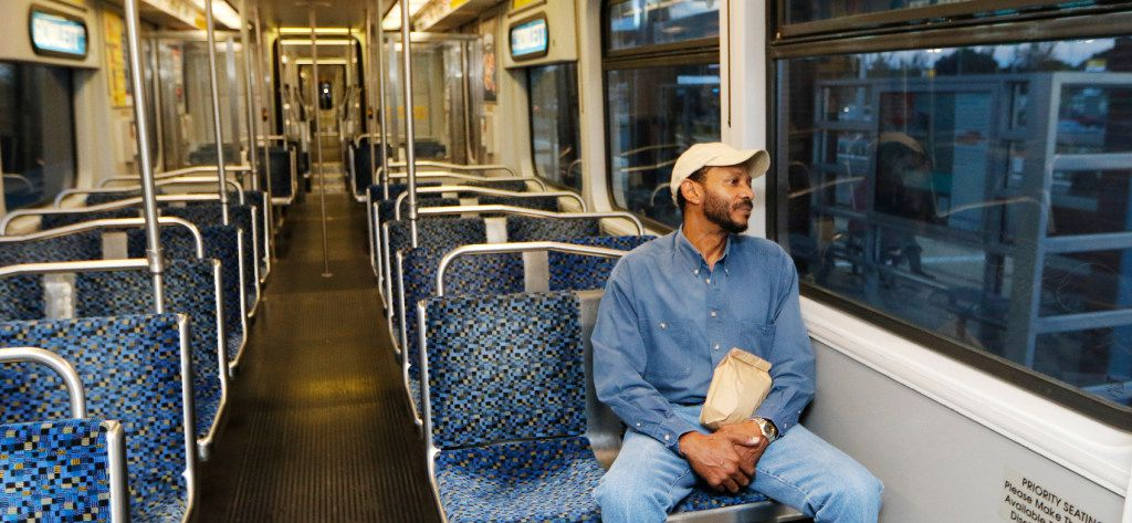 DART passenger Rodney Nelms waits for the Blue Line train to depart at UNT Dallas Station in southern Dallas on Monday. Today was the first day of service. (David Woo/The Dallas Morning News)