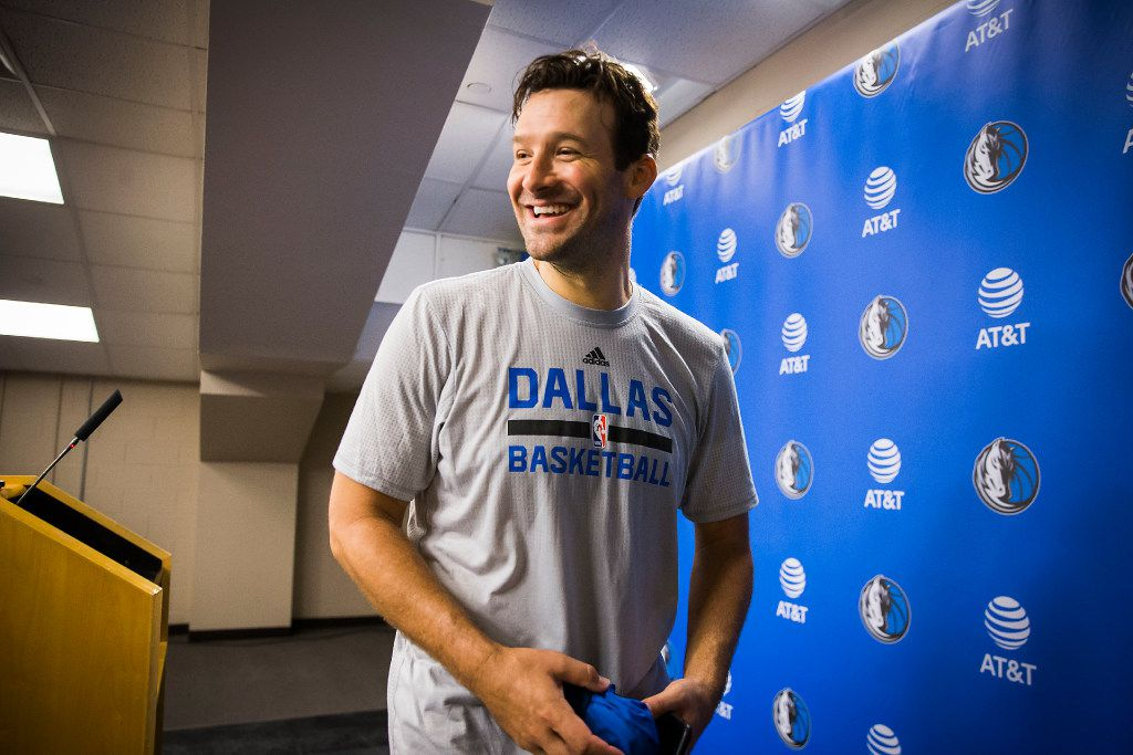 Tony Romo smiles as he leaves a press confernce following the Dallas Mavericks morning shootaround before a game against the Denver Nuggets at the American Airlines Center on Tuesday, April 11, 2017, in Dallas. The former Cowboys quarterback will be honored Tuesday night as a Maverick for a day, taking part in the NBA team's pregame warm ups and wearing a No. 9 jersey. (Smiley N. Pool/The Dallas Morning News)
