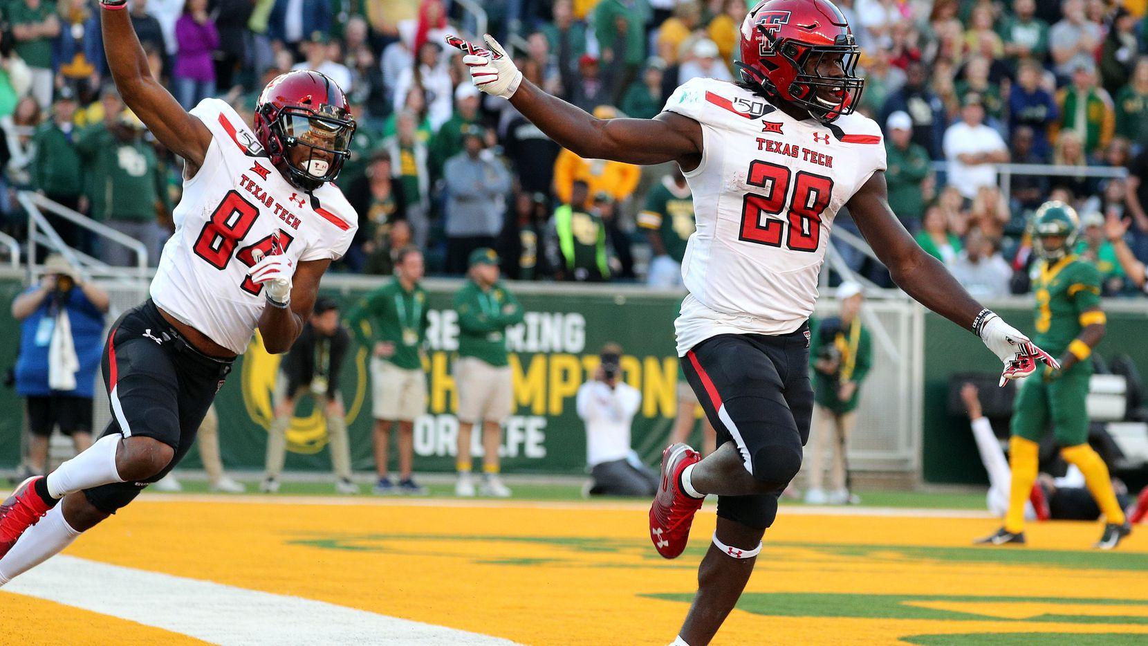 WACO, TEXAS - OCTOBER 12: Erik Ezukanma #84 and SaRodorick Thompson #28 of the Texas Tech Red Raiders celebrate a fourth-quarter touchdown against the Baylor Bears on October 12, 2019 in Waco, Texas.