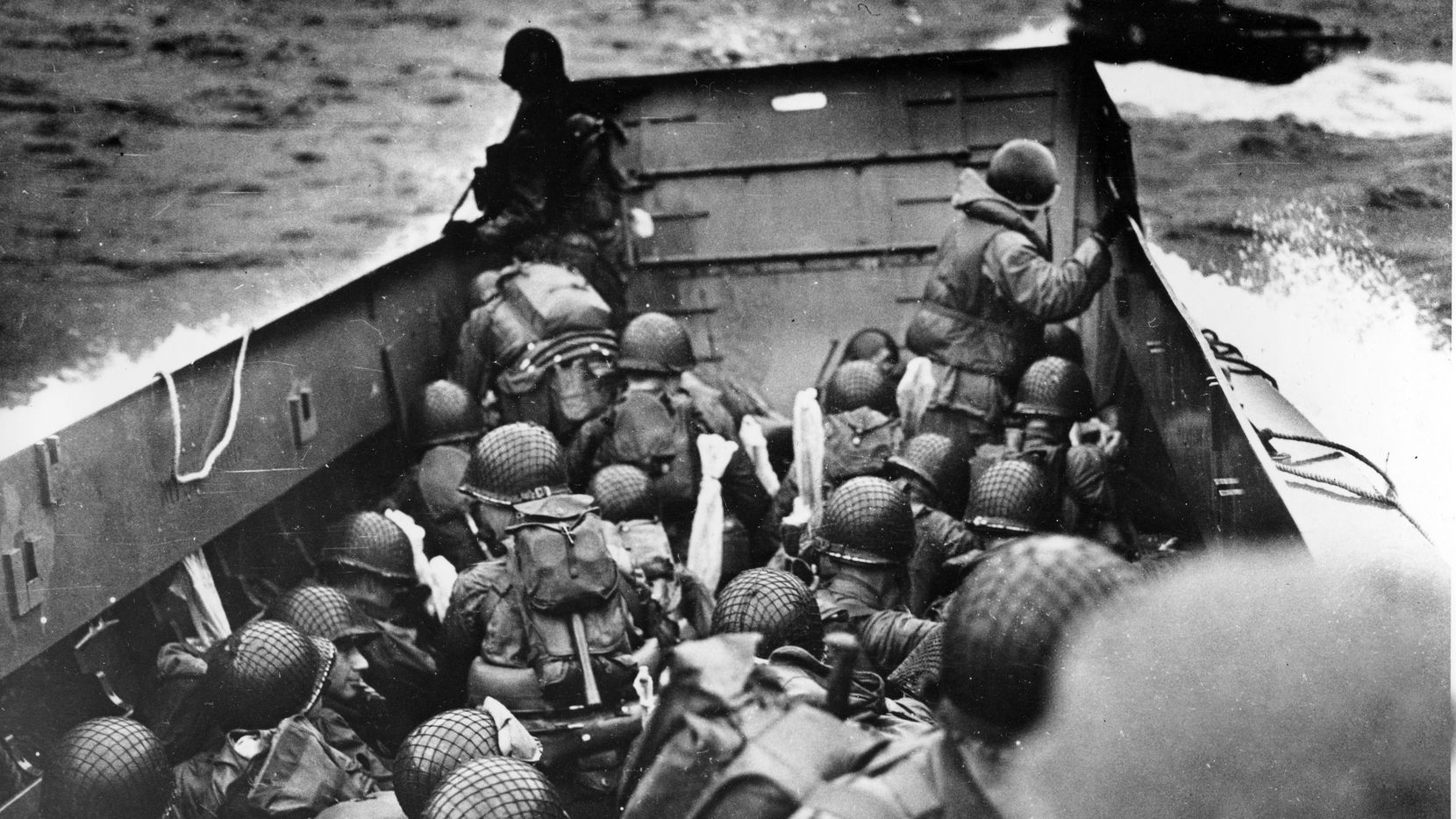 In this June 6, 2014, file photo, allied troops crouch behind the bulwarks of a landing craft as it nears Omaha Beach during a landing in Normandy, France.  The D-Day invasion  broke through Adolf Hitler's western defenses and led to the liberation of France from Nazi occupation just as the Soviet Army was making advances in the east, turning the tide of the war in the Allies' favor. First responders will get to see a film about it for free on Friday.""