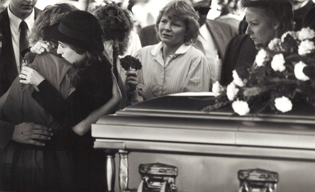 Martha Asbury, the fiancée of slain Midlothian undercover police Officer George Raffield, was comforted by family and friends at his funeral on Oct. 27, 1987, in Waxahachie.