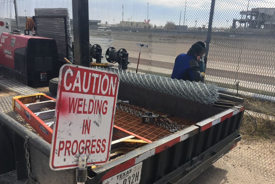 A welding crew repairs holes in the border fence dividing El Paso and Ciudad Juarez almost daily. (Angela Kocherga/Staff)