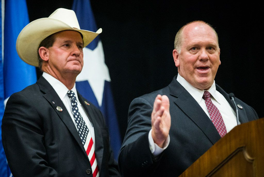 Tom Homan (right), acting director of U.S. Immigration and Customs Enforcement, was joined by Texas sheriffs, including A.J. Louderback of Jackson County, at the Gaylord Texan in Grapevine on Monday.