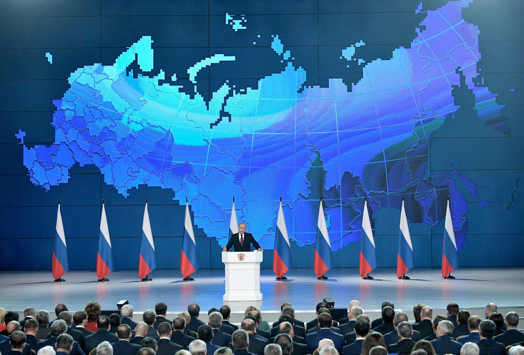Russian President Vladimir Putin delivers a state-of-the-nation address in Moscow on Feb. 20, 2019. Putin sternly warned the United States against deploying new missiles in Europe, saying that Russia will retaliate by fielding new weapons that will take just as little time to reach their targets.