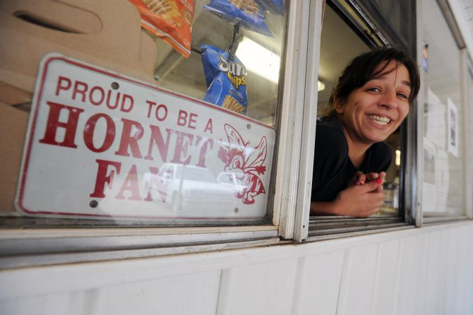 In this April 15, 2013 photo, Staci Ward takes your order at the Hornet Drive-In, the gossip hub of Serepta, La. The restaurant is a good place to stop for a snack while traveling the Trails and Byways tour.