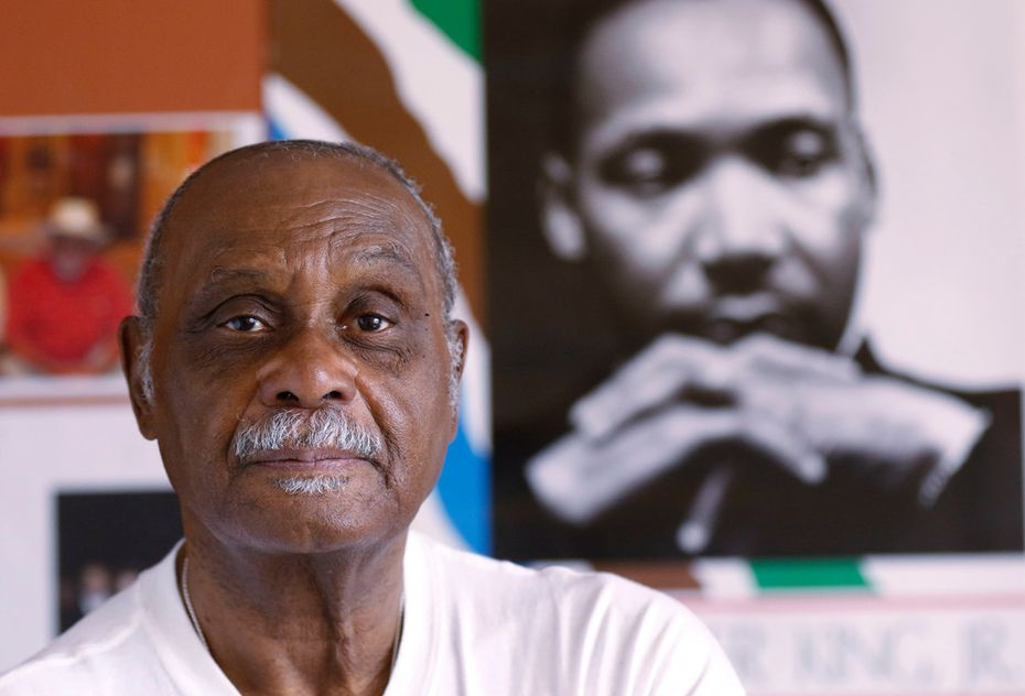 The Rev. Peter Johnson of Dallas in front of a poster of the Rev. Martin Luther King Jr., his former boss. Johnson, known as Dallas' dean of civil rights, is the founder of the Institute for Non-Violence. He wants an outside investigation of the DeSoto police Department.
