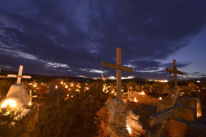 More than 400 graves in the Terlingua Ghost Town cemetery are decorated with votive candles on Dia De Los Muertos.