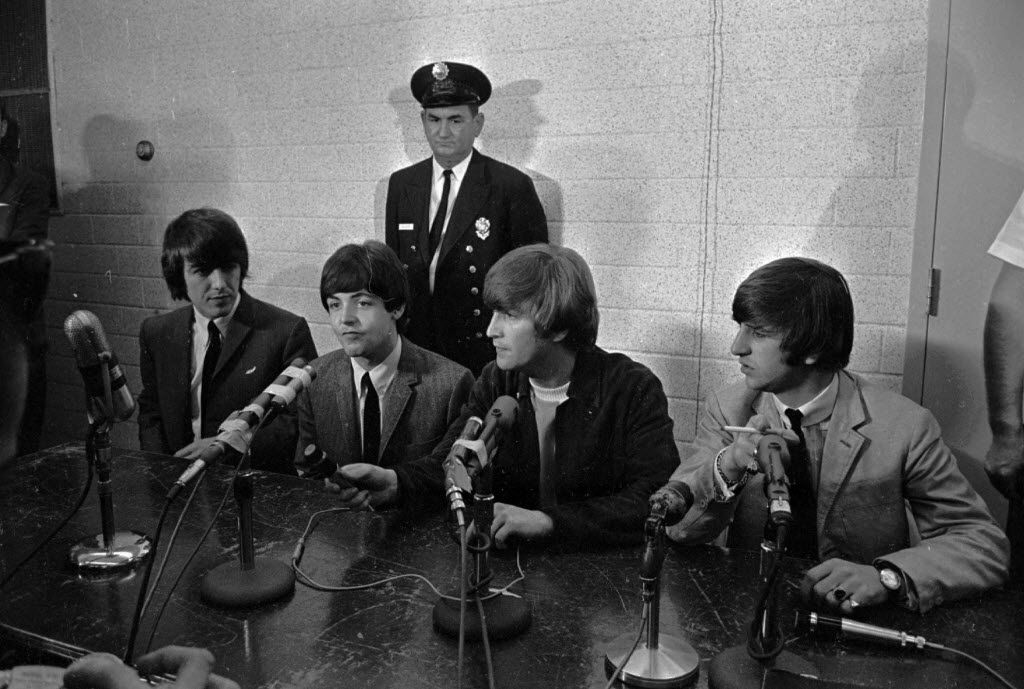 George Harrison (from left), Paul McCartney, John Lennon and Ringo Starr sat before a battery of microphones in Dallas on Sept. 18, 1964, as they held a news conference before their concert.