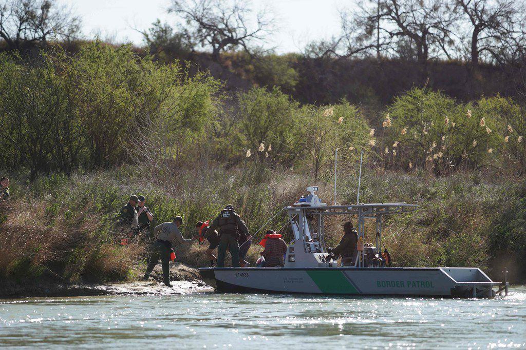 Central American immigrants are taken into custody as they cross into the U.S. from Piedras Negras in Mexico this month.