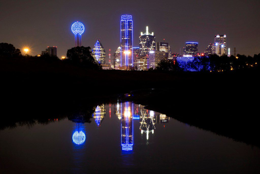 The downtown Dallas skyline lights up in blue in recognition of National Police Week on May 15, 2017.
