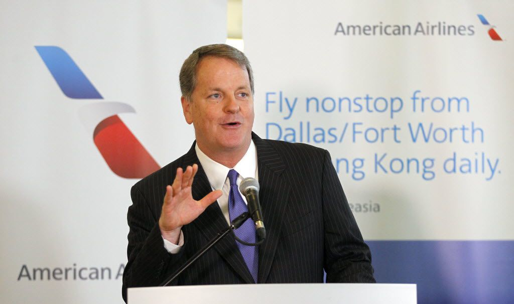 American Airlines CEO Doug Parker marks the occasion before the inaugural American Airlines nonstop flight from Dallas/Fort Worth International Airport (DFW) to Hong Kong International Airport (HKG) took off from Terminal D Wednesday, June 11, 2014. (Tom Fox/The Dallas Morning News)