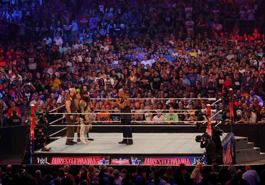 The Rock is confronted by Erick Rowan, a member of The Wyatt Family, at WrestleMania 32 at AT&T Stadium in Arlington, TX, Sunday, April 3, 2016. (David Guzman/The Dallas Morning News)