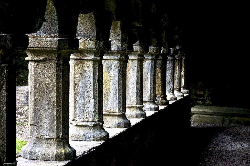 On a cloudy day, light breaks through the courtyard columns at Sligo Abbey, a ruin built in the 13th century in Ireland.