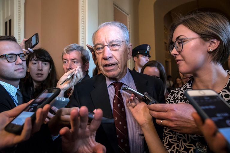 Senate Judiciary Committee Chairman Chuck Grassley, R-Iowa, talks to reporters as he emerges from a meeting with Senate Majority Leader Mitch McConnell, R-Ky., after the Republican leaders agreed to delay a final vote on Supreme Court nominee Brett Kavanaugh to allow time for an investigation by the FBI of the sexual misconduct allegations against him, at the Capitol in Washington, Friday, Sept. 28, 2018. (AP Photo/J. Scott Applewhite)