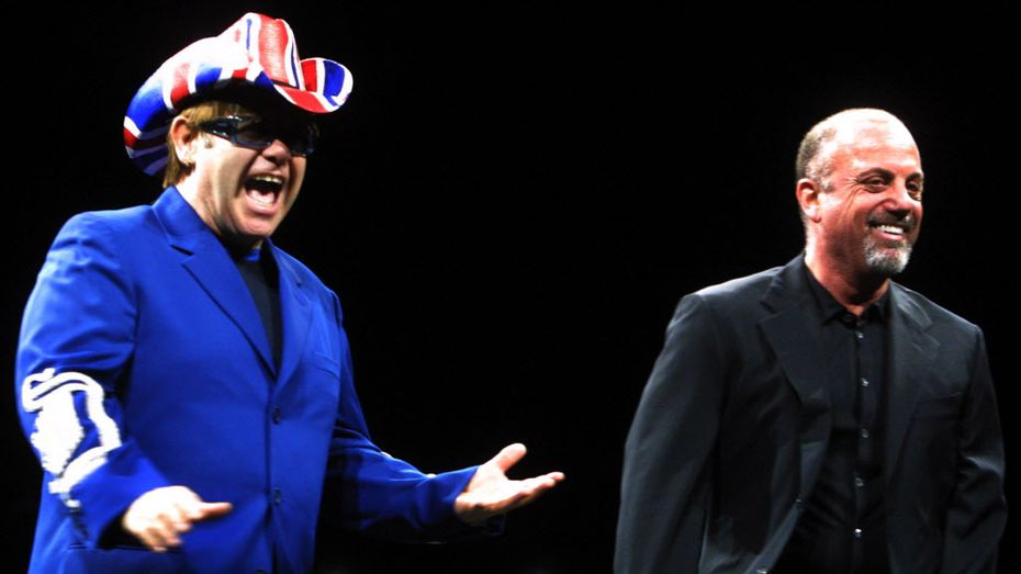February, 28, 2003: Elton John, left, and Billy Joel greet the crowd at  at the American Airlines Center in Dallas.