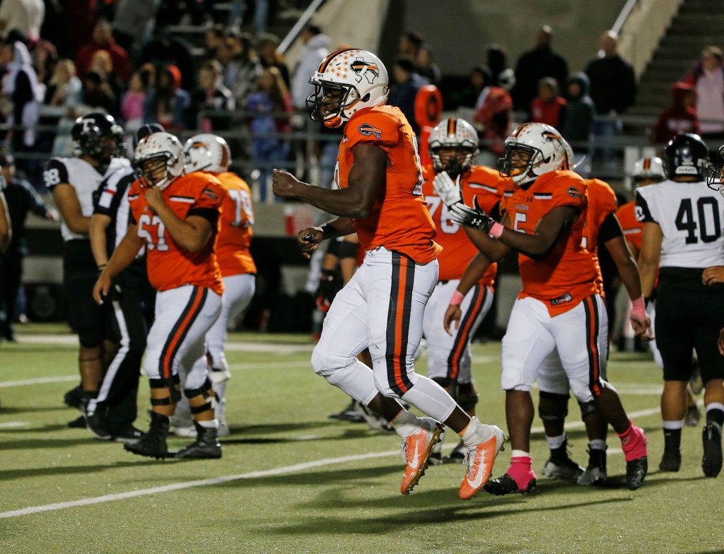 Haltom quarterback Adam Hill (10) celebrates at they defeated Euless Trinity during their high school football game on Oct. 11, 2019 in North Richland Hills. Haltom defeated Trinity 23-20. (Michael Ainsworth/Special Contributor)