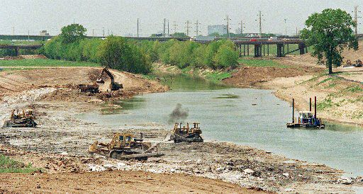 Construction workers dig out the  Trinity River channel north of the Corinth Street Viaduct in 1996 to shore  up levees in case of a major flood in Dallas. More work was done to reservoirs and floodway systems after Hurricane Katrina.