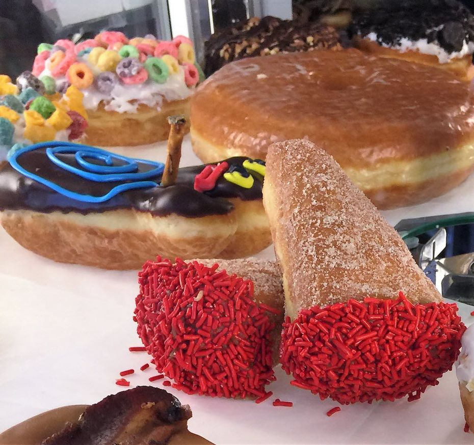 Colorful sugary creations entice doughnut lovers 24-hours a day at Voodoo Doughnut, Portland.